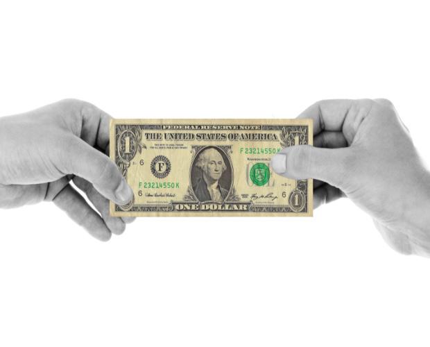 dollar bill held between two hands